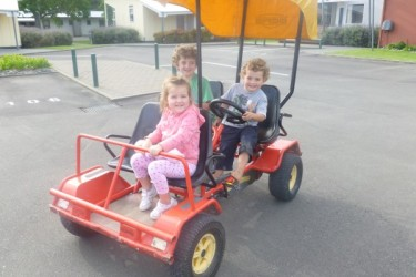 Autumn - George, Oli and Tui on a pedal car